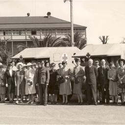Woolies team present ambulances to the Army in 1940s
